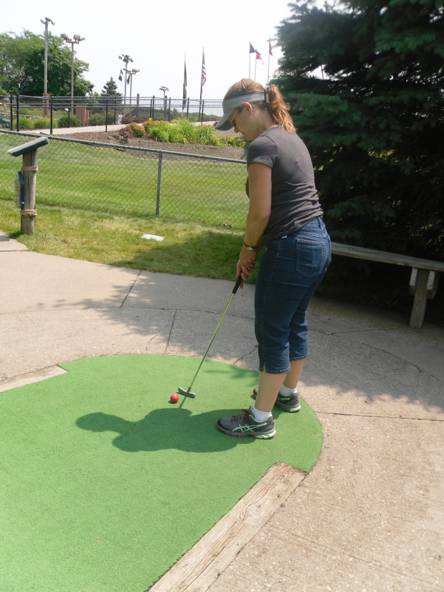 Angie golfing