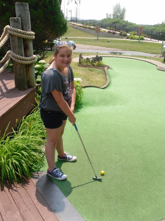 Carly golfing